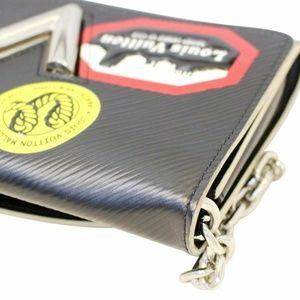 dc25339e3d7a Louis Vuitton Bags - LOUIS VUITTON Epi World Tour Twist Chain Wallet